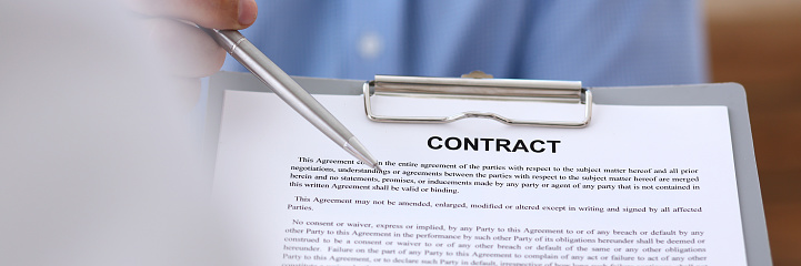 863148614 istock photo Male arm in suit offer contract form on clipboard pad 871428154