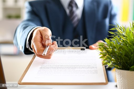 863148614istockphoto Male arm in suit offer contract form on clipboard 876838138