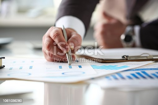 istock Male arm point silver pen at important paper 1061036280