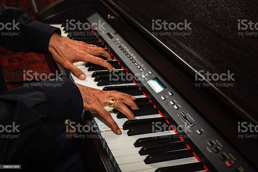 Male Asian Hands on Digital Piano Keyboard stock photo