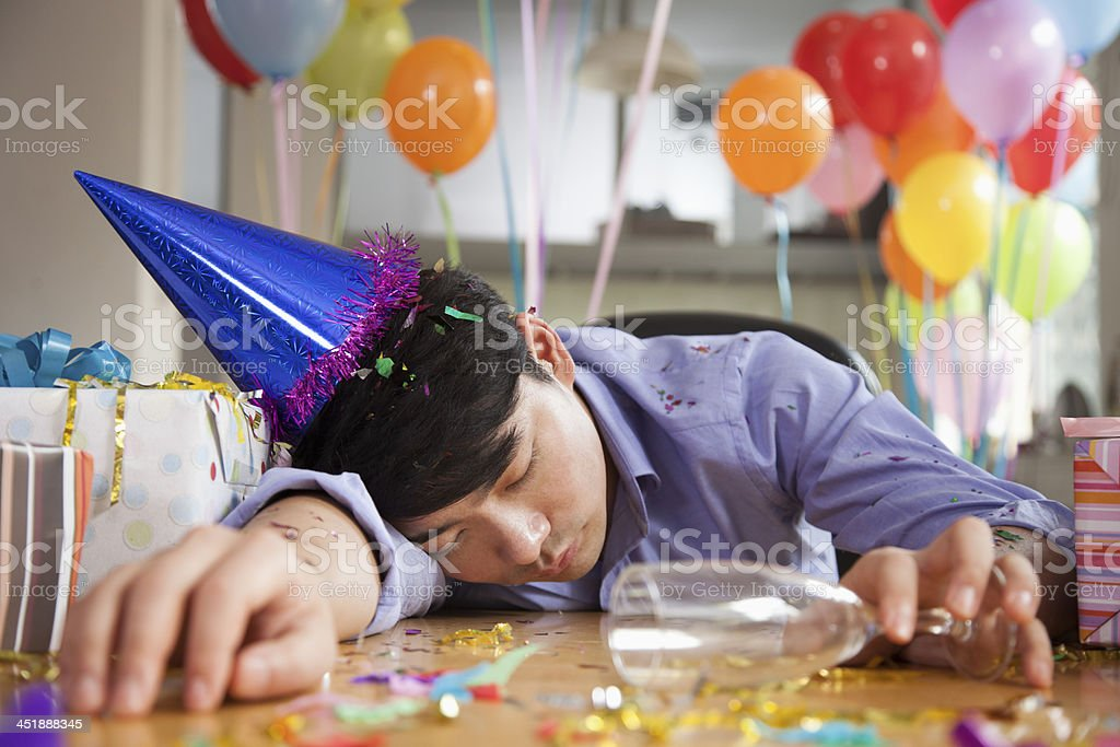 Male Asleep After Party at Office stock photo