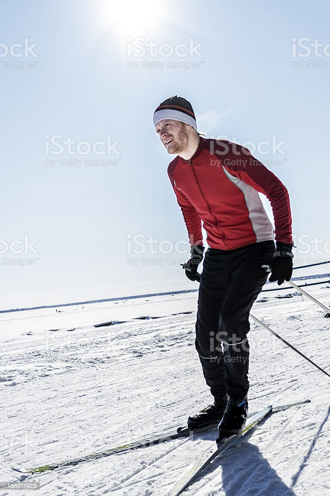 Male athlete cross-country skiing. stock photo