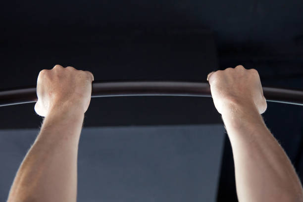 Male Athlete doing Chin-ups stock photo