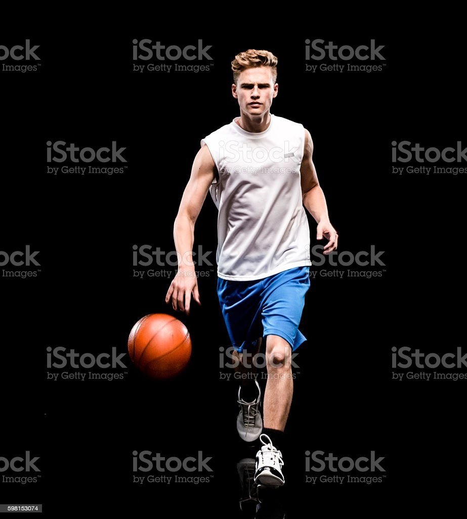Male athlete dribbling stock photo