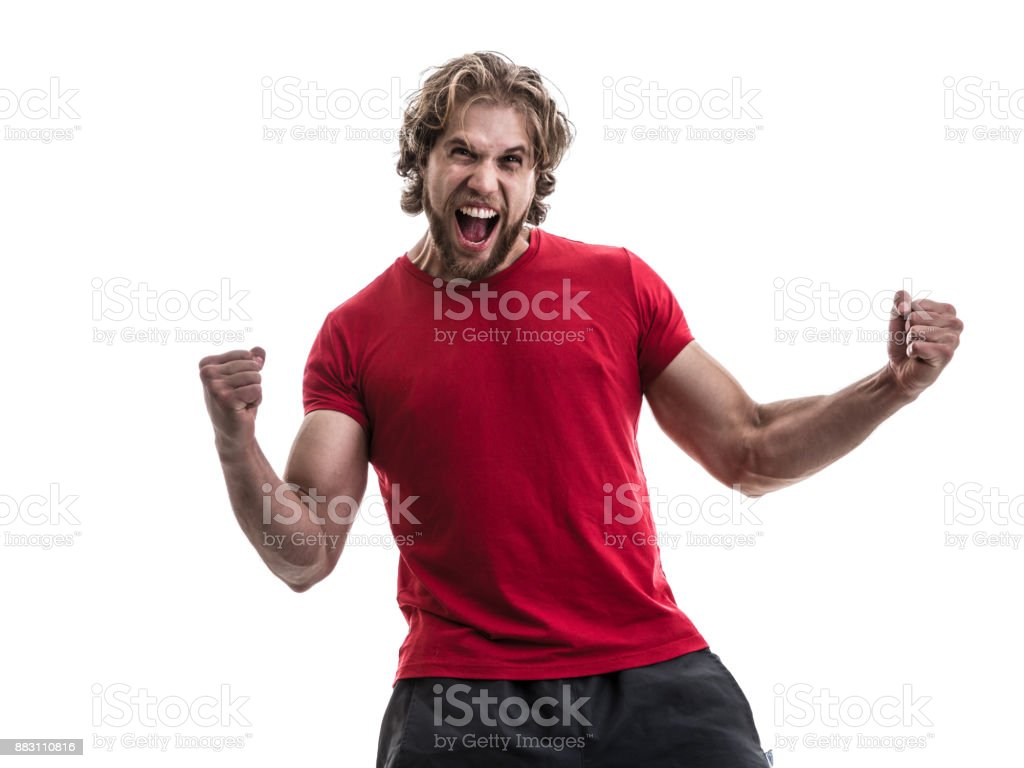 Male athlete / fan in red uniform celebrating on white background stock photo