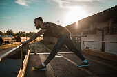 istock Male athlete having a sports training class in the city street 1138942022