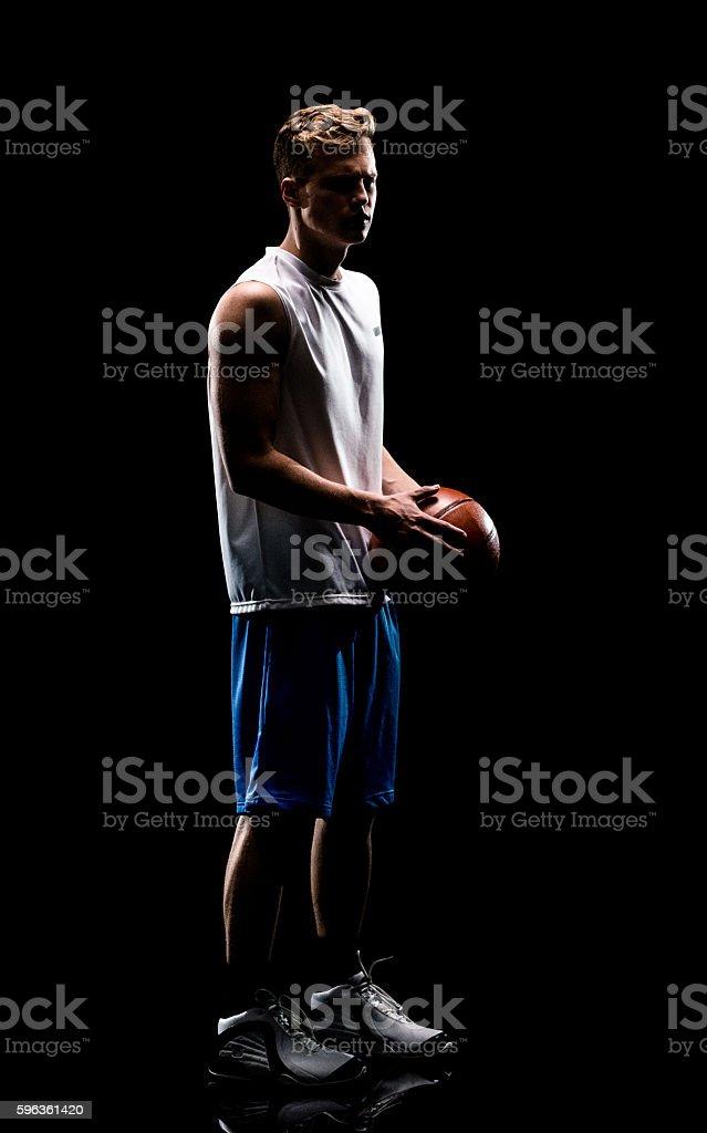 Male athlete holding basketball royalty-free stock photo