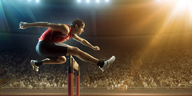 Male athlete hurdling on sports race​​​ foto