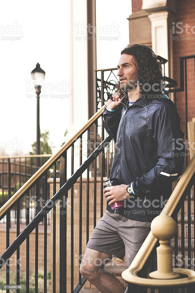 Male athlete leaving his home for an early morning workout. stock photo