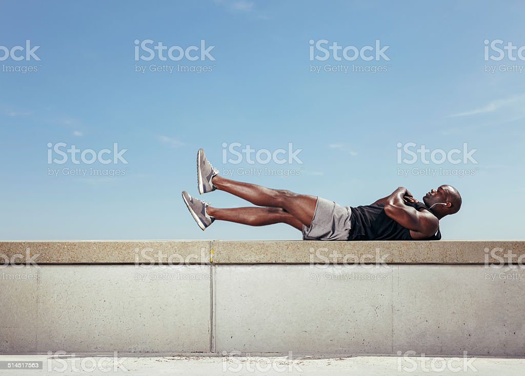 Male athlete making abdominals stock photo