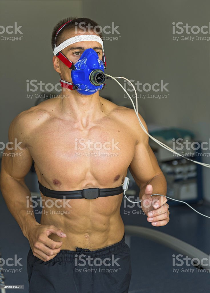 Male Athlete Performing ECG and VO2 test on Treadmill royalty-free stock photo