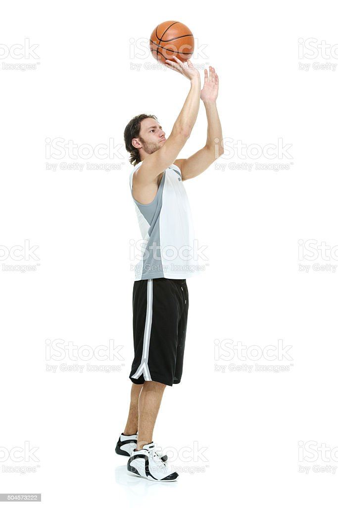 Male athlete playing with basketball stock photo