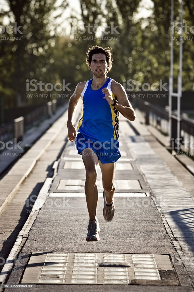 Male athlete running photo libre de droits