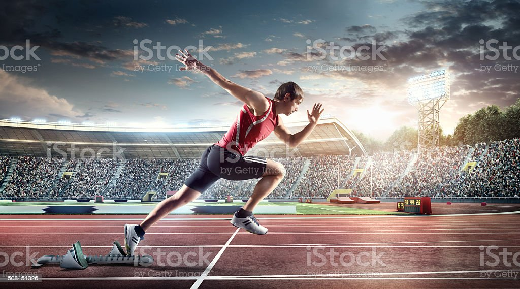 Male athlete sprinting stock photo