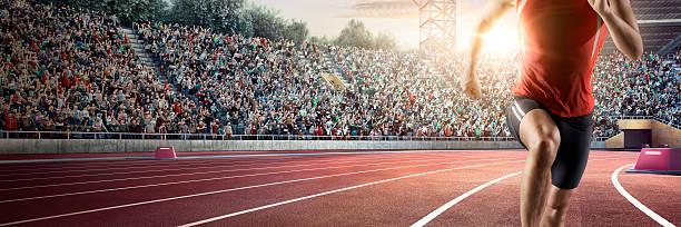Male athlete sprinting stock photo