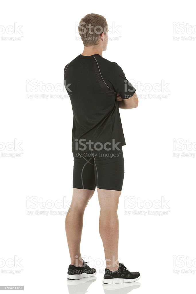 Male athlete standing with his arms crossed royalty-free stock photo