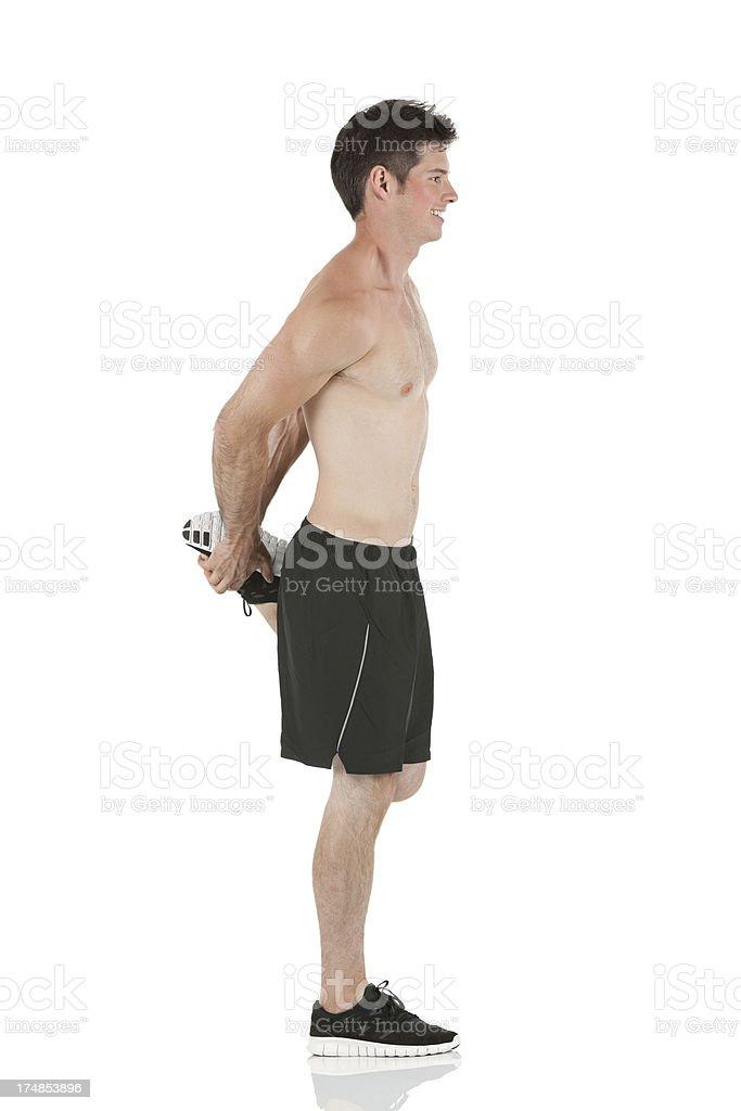 Male athlete stretching his leg royalty-free stock photo