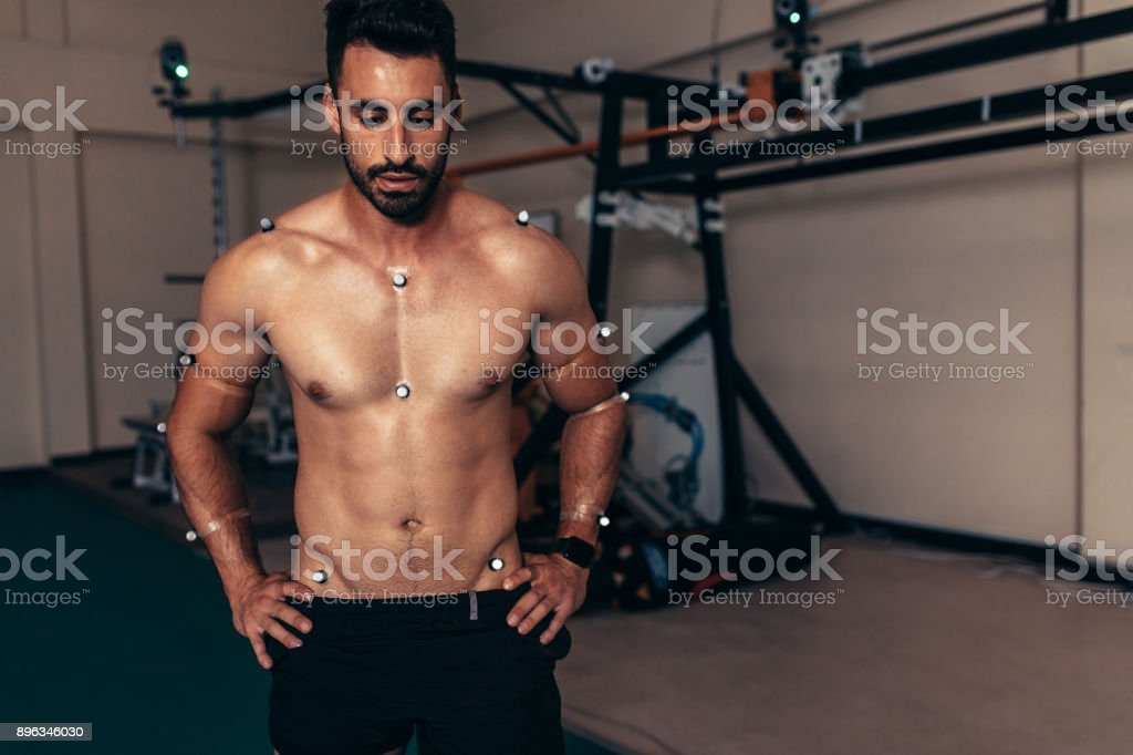 Male athlete testing is performance in biomechanics lab stock photo