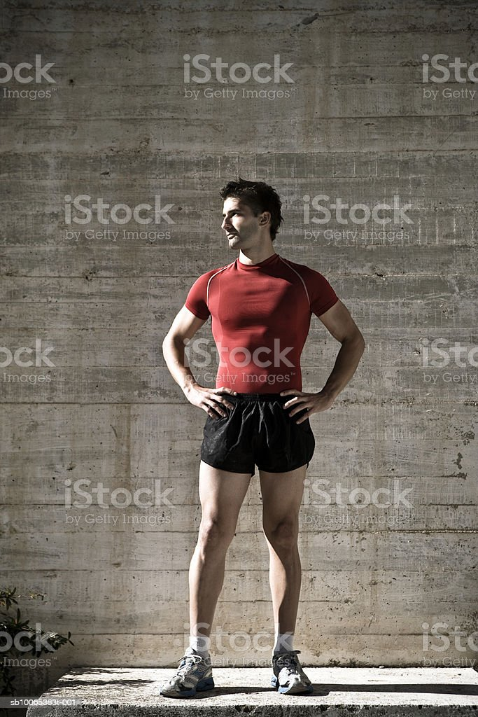 Male athlete with hand on hip, looking away royalty-free stock photo