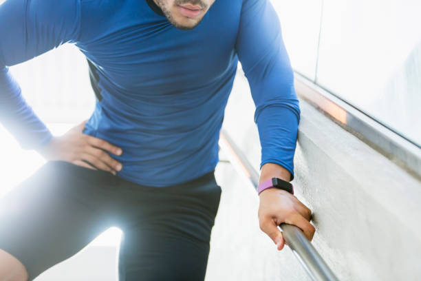 Male athlete with hip injury stock photo