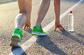 Male athletes in running shoes. Jogging