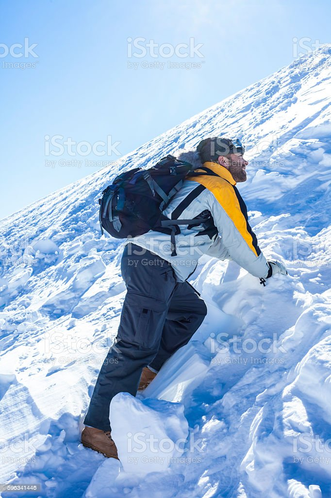Male backpacker climbing on snow mountain royalty-free stock photo