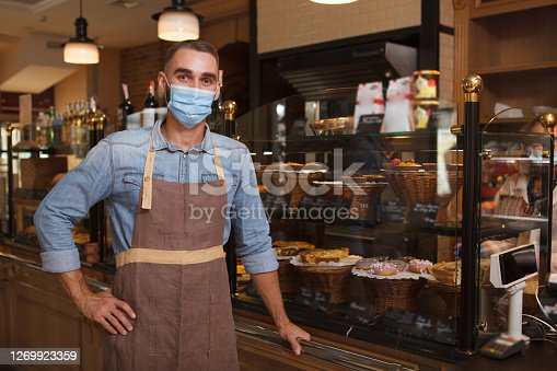 istock Male baker working at his bakery 1269923359