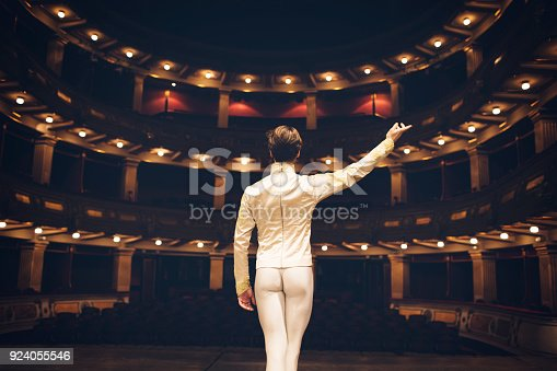 Male ballet dancer on rehearsal at stage theatre.