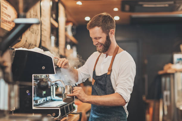 male barista making cappuccino - busy restaurant kitchen stock pictures, royalty-free photos & images