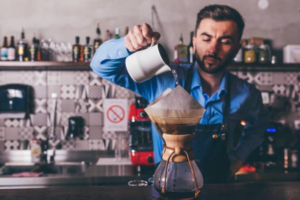 Male barista making filter coffee stock photo