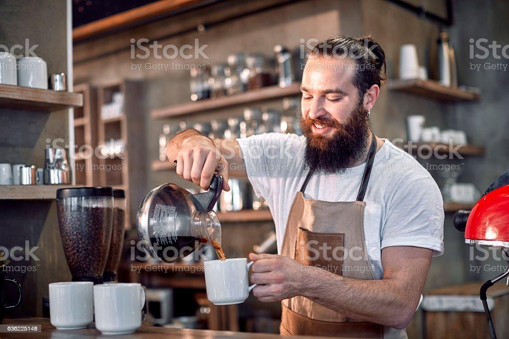 Male barista preparing coffee stock photo