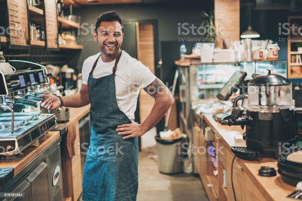 Male barista preparing espresso stock photo