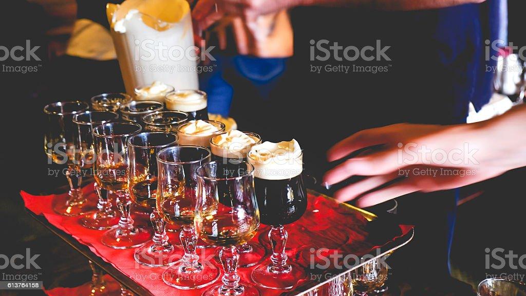 Male bartender making Irish Coffee stock photo