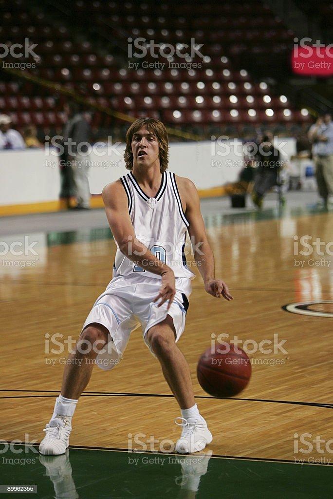 Male Basketball Player Executes NoLook Bounce Pass