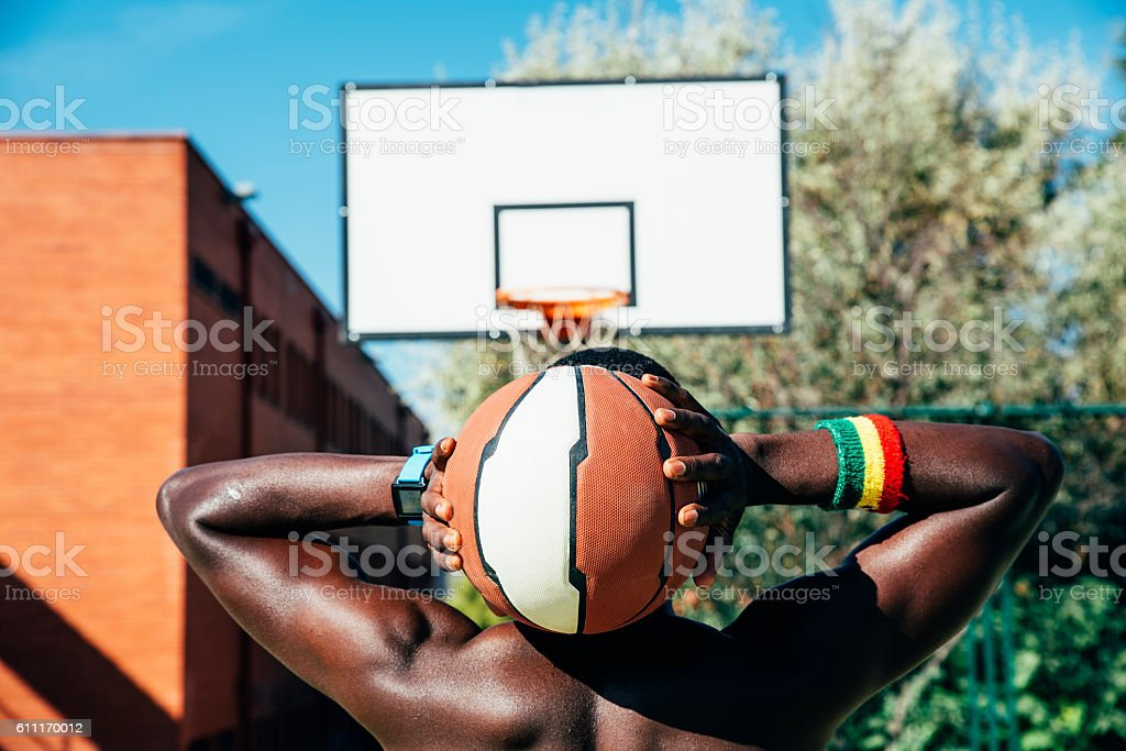 Male basketball player holding a ball. stock photo