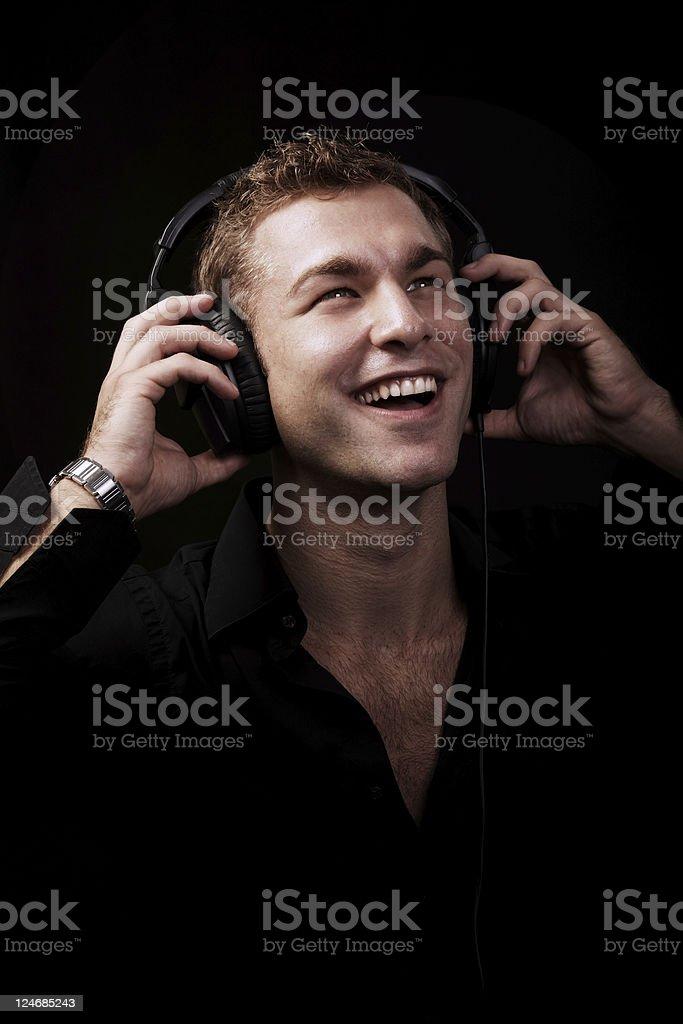 Male Beauty Portrait with Headphones. Black Background stock photo
