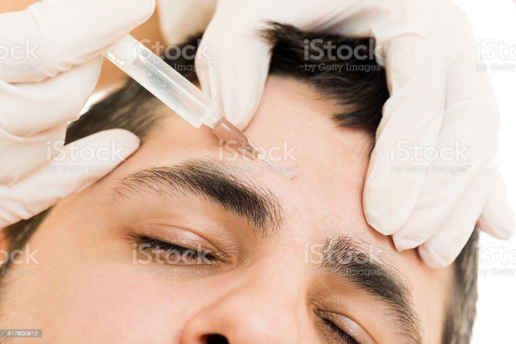 Male beauty treatment stock photo