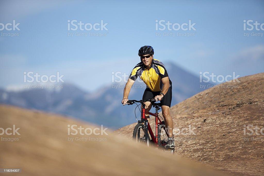 Male Biker Riding Through Rugged Terrain In Moab, Utah royalty-free stock photo