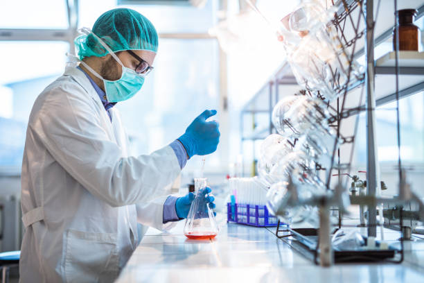 Male biotechnologist testing new chemical substances in a laboratory. stock photo