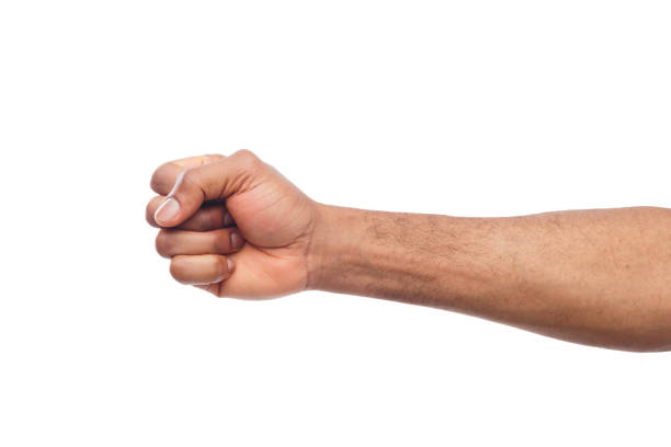 male black fist isolated on white background - fist stock photos and pictures
