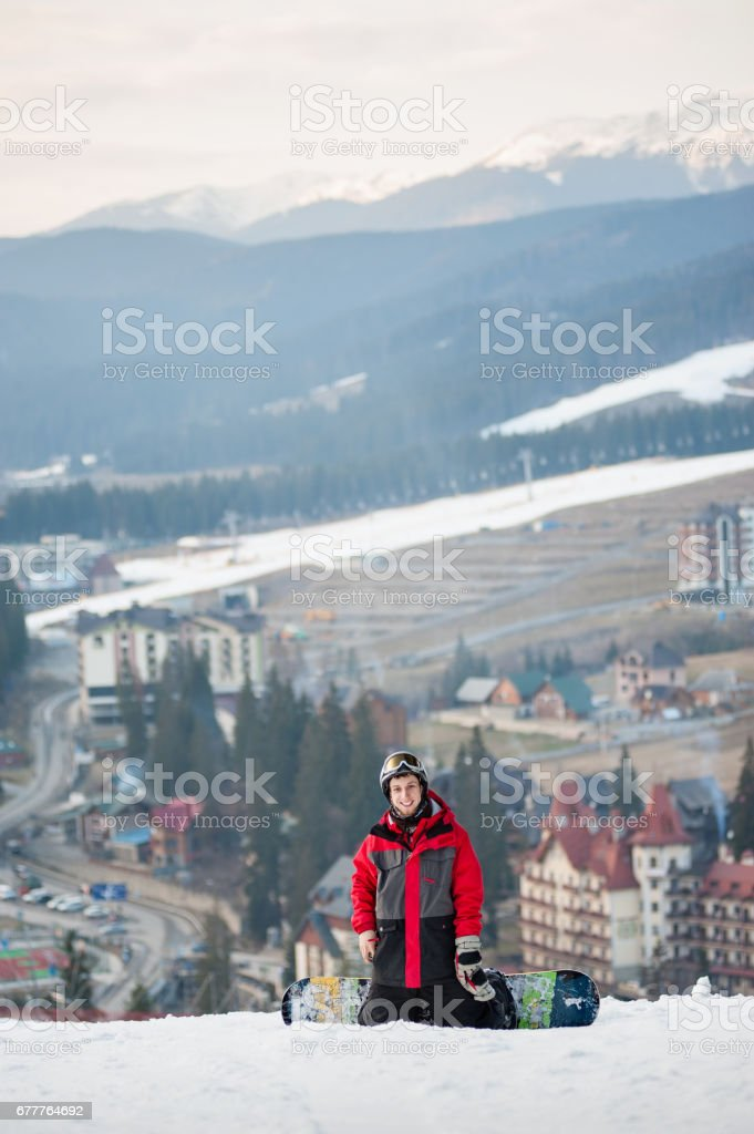 Male boarder on his snowboard at winer resort royalty-free stock photo