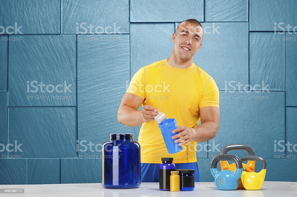 Male bodybuilder with supplement stack royalty-free stock photo