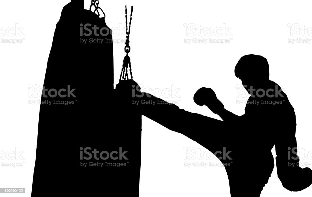 male boxer exercising with boxing bag. Male boxer hitting heavy bag during training. Male boxer training with the punch bag stock photo