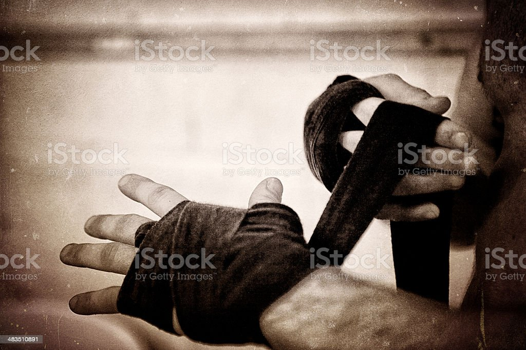 Male boxer wrapping hands stock photo