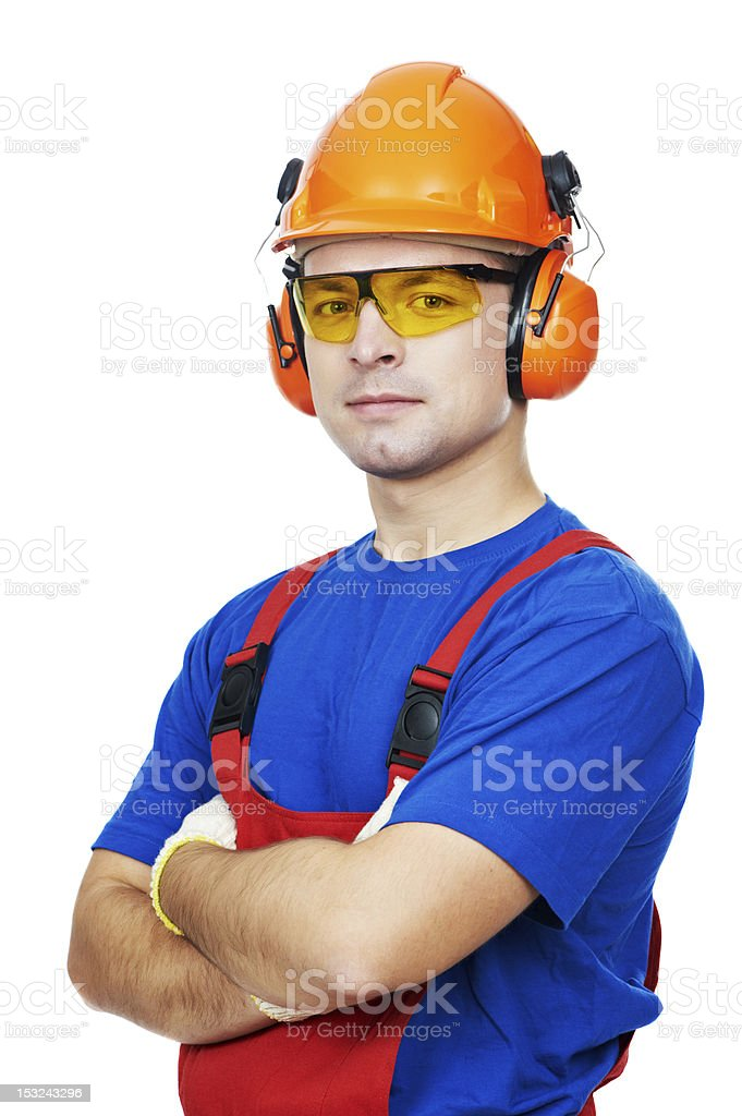 Male builder in orange hard hat, earmuffs and goggles stock photo
