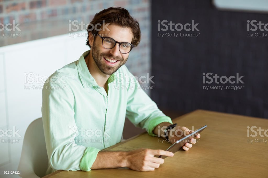Male business executive holding digital tablet stock photo