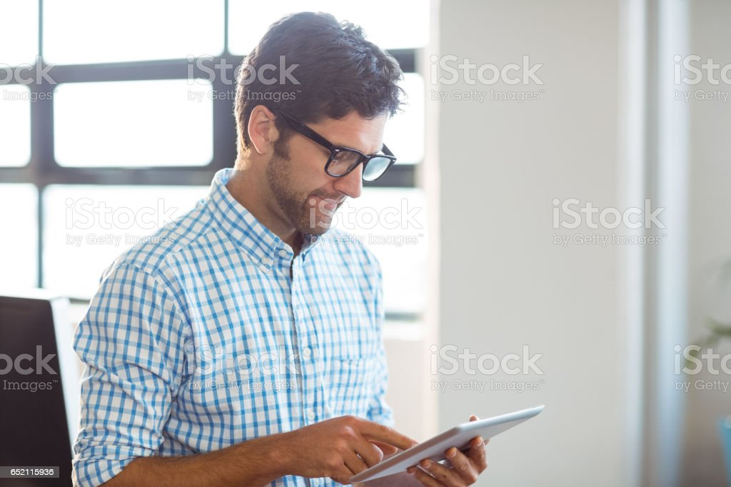 Male business executive using digital tablet stock photo