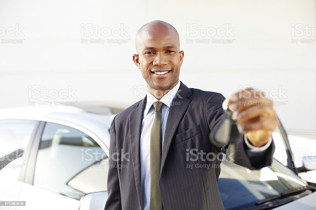 Male Business Professional Holding Car Key stock photo