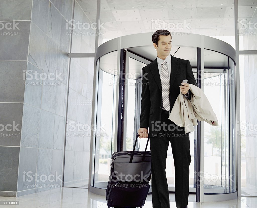 Male business traveler with cell phone royalty-free stock photo