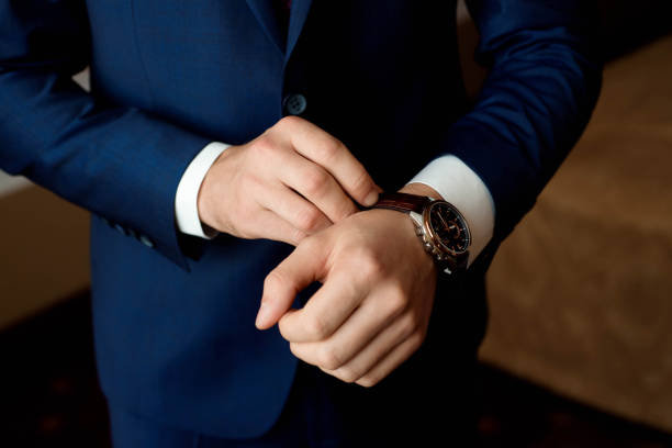 male-businessman-dresses-and-adjusts-his-watch-preparing-for-a-clock-picture-id1138834669?k=6&m=1138834669&s=612x612&w=0&h=OCSS99f7jJWma6JBThu04_tzvieyNmk9PoLXPfBZKas=